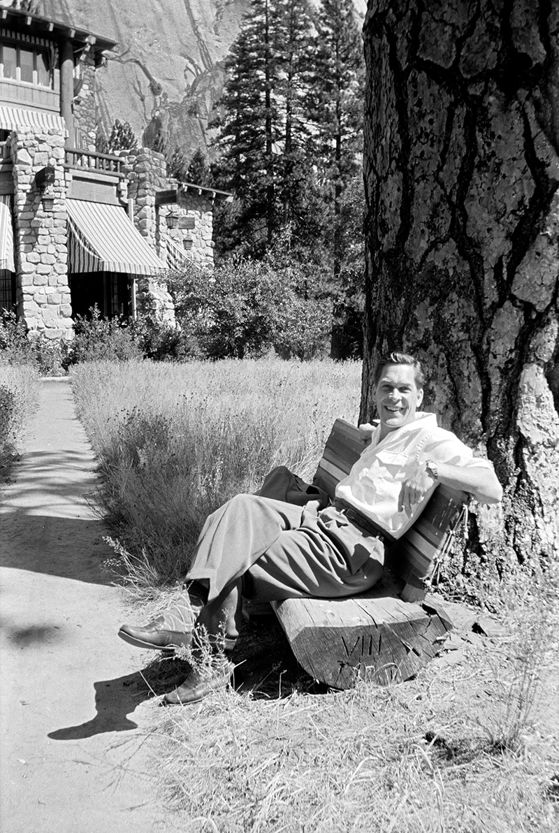 "Ned Scott portrait: Ned Scott relaxes at one of his favorite haunts near Kayenta in Northern Arizona in 1938.  Rock escarpments in the background inspired him to compare the area to New York in a 1935 letter: ""If one could spend every moment of every day seeing all there is in New York they would not feel as I do today--still in a coma--still in fairlyland"". Photo snapshot by Gwladys Scott."