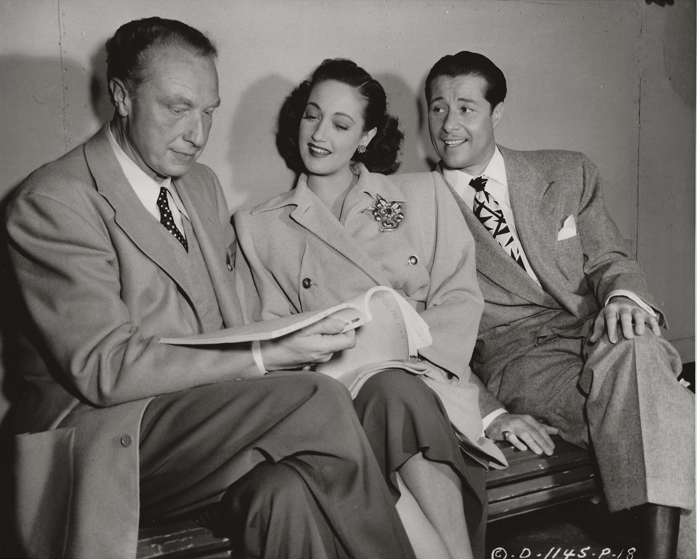 Director Douglas Sirk and actors