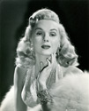 "Lovely Adele Jergens, described as ""the champagne blonde"" by her fans, plays an important part with George Brent and Joan Blondell in Columbia's new mystery spine-tingler, Director Henry Levin's film,  ""The Corpse Came C.O.D."", 1947.  Famed costume designer Jean Louis created Miss Jergen's gowns for the film."