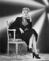 "A dramatic fashion portrait of Adele Jergens dating from the late '40's.  No film designation is listed, but it is most likely Director S. Sylvan Simon's film noir mystery drama, ""I Love Trouble"" or Director Howard Bretherton's action thriller, ""The Prince of Thieves"", both from 1948.  Ned Scott used structured backgrounds, called ""rear projection"" to enhance the drama of the image."