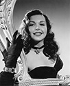 Ann Miller, posed as Linda Lorens, a star performer in a Rio revue,  in The Thrill of Brazil, 1946.