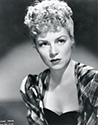 A character pose of Claire Trevor as the outcast girl for John Ford's Stagecoach, 1939.