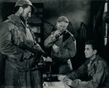Robert Mitchum, Burgess Meredith and Gene Garrick from Ernie Pyle's