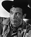 Perpetual saddle tramp Cole Harden, played by Gary Cooper in this portrait, functions as a counterfoil for self appointed hanging Judge Roy Bean, played by Walter Brennan, in a small Texas community where free-range cattle interests clash with homesteaders who have moved into the area.  William Wyler's romantic Western drama, 'The Westerner', 1940.