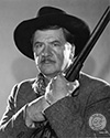 "Stagecoach 1939 film: A portrait of George Bancroft as U.S. Marshall ""Curly"" Wilcox in John Ford's epic Western drama, ""Stagecoach"".  Walter Wanger Productions staff members applied this caption on the back of this print in Ned Scott's personal collection: George Bancroft in the role of ""Curly"", a U.S. Marshall, in Walter Wanger's production ""Stagecoach"".  Bancroft again plays the type of character that has made him famous--a rugged, two-fisted he-man. This production marks the 14th anniversary since climbing to stardom"". Director John Ford's epic Western drama, ""Stagecoach"", 1939."
