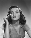 Gloria Henry photos: Ned Scott snapped this portrait photo of Gloria Henry as she prepares her make-up for one of roles in Columbia Pictures film in the late 1940's.
