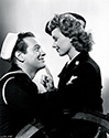 "Janet Blair and Al Drake, as Christine Bradley and Howard Young, share a romantic moment in Director Alfred E. Green's wartime musical and dance production, ""Tars and Spars"", 1946."