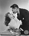 "Franchot Tone and Janet Blair share a torrid moment in costume and onset for this nifty noir mystery film from Columbia Pictures.  Tone plays the private eye Stuart Bailey who is hired by an aggrieved husband to find his wife who has gone missing, but in actuality, was murdered by the husband.  Janet Blair plays the wife's sister who gets involved with Bailey more out of circumstance than true attraction.  Director S. Sylvan Simon's film noir mystery, ""I Love Trouble"", 1948."