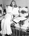 "Lizabeth Scott takes a smoke break during filming of director John Cromwell's film noir mystery ""Dead Reckoning"" 1947.  Lizabeth Scott plays the role of Coral, widow of murdered friend of Capt. Rip Murdock played by Humphrey Bogart."