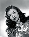 In full costume regalia, Maylia poses for a portrait to support her role as Shu Pan Wu, Chinese drug villain in Columbia Pictures'  To The Ends of the Earth, 1948.  Only 20 years old when sitting for this portrait in her debut film, Maylia was billed by Columbia as the next Anna Mae Wong.  Columbia had big plans for her, but this was not to be.  She met and married actor Benson Fong only a few weeks into filming, and quickly became pregnant with her first child.  Sadly, her stunted career produced only a few films and images such as this one.  She remained married to Fong until his death in 1985.  Maylia means 'beautiful' in Cantonese.