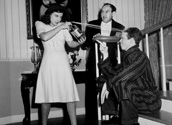 Paulette Goddard pics: An on-set photograph of action at a domestic dust-up with Paulette's character, Molly McKorkle giving Jimmy Stewart's charcater, Jimmy Haskell the business with the soda spritzer.  Looking on with surprise is Charlie Arnt who plays Parks, the butler.  James Roosevelt's romantic comedy, Pot O' Gold, 1941.