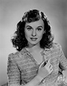 "A postrait of Paulette Goddard to support her role as Molly McKorkle, a young and beautiful Irish girl.  Molly crosses paths with Jimmy Haskel, a down and out musician who has just failed in a music business.  Things get complicated when Jimmy starts work for his cranky uncle, C.J. Haskel (Charles Winninger) who owns a health food business and hates music.  Molly's family runs an in-house band that needs a little help.  Jimmy finds it irresistable to do his best to help Molly's family, thereby improving his chances with the pretty Irish girl.  Director George Marshall's romantic, musical comedy, ""Pot O' Gold"". 1941"