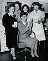 Rosalind Russell signs autographs for a group of hair stylists at Columba Studios in 1943 while she was starring in 'What a Woman'.  From left to right, flanking Rosalind Russell who is seated, are Rhoda Donaldson, Hazel Keats, Flore' and Helen Hunt, chief hair stylist for Columbia Pictures.
