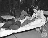 "Director Josef von Sternberg and Ona Munson, sharing a quiet moment of rest during filming of ""The Shanghai Gesture"", 1941."