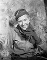 "Burgess Meredith portrays a relaxed Ernie Pyle, cigar in hand, somewhere on the front lines in Northern Africa during Operation Torch in Director William Wellman's biographical wartime drama, ""The Story of G.I. Joe"", 1945."