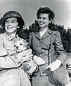 Cadet Nurse Beulah Tyler poses with Nurse Lieutenant Red Murphy on the set of The Story of G.I. Joe.  Red Murphy was played by Director William Wellman's wife, Dorothy (Dottie) Coonan.