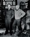 Pausing for a moment's reflection, Ernie Pyle, author of Here Is Your War and Burgess Meredith, star of the upcoming movie Story of G.I. Joe share thoughts while on the movie set.