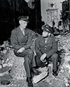 Ernie Pyle interviews Pvt. Kenneth Fowler of the 34th Infantry Division, a combat veteran of the North African and Sicilian campaigns of 1942-43.  Ernie Pyle performed many similar interviews while serving as a U.S. War Correspondent during his tour of duty with the U.S. Army.  These interviews formed the basis of his many news dispatches sent to outlets back in the United States.  And these together with his own stories of his many weeks at the front create the core of his famous book , Here Is Your War, on which the film The Story of G.I. Joe is based.