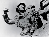 Robert Mitchum in his role as Capt. Henry Waskow prepares to throw a hand grenade at enemy positions in the film Story of G.I. Joe.  This photograph is the talisman image of the film and it is found today in posters, DVD covers and publication headers for the film.