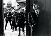 Nazis search the town for assassin Karel Vanek, played by Brian Donlevy, who has just successfully killed Reich-Protector Reinhard Heidrich, alias The Hangman