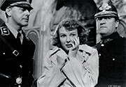 Anna Lee plays Masha Novotny in a moment of abject terror as the Nazis arrest her father, Professor Novotny (Walter Brennan) for questioning after the assassination of Reich Protector Reinhold Heidrich in Fritz Lang's tense wartime drama 'Hangmen Also Die', 1943