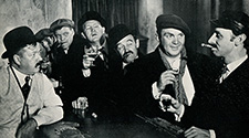 Crew members of the S.S. Glencairn catch up with their drinking in a Limehouse pub while on shore leave just prior to their departure on a perilous voyage with dangerous cargo.  John Ford's epic drama of the sea, ' The Long Voyage Home', 1940