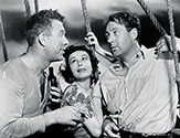 Ward Bond as Yank and Ian Hunter as Smitty discuss things over a pint while Carmen Morales looks on in scene from John Ford's Long Voyage Home 1941