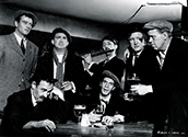 The crew of the S.S. Glencairn enjoys a boozy evening in the dockside pubs before shipping out on their long journey with dangerous cargo in John Ford's The Long Voyage Home, 1940
