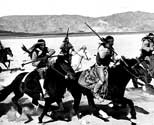 "Navajo Indians, recruited to play the role of maurauding Apache Indians, ride to attack the coach in Walter Wanger's ""Stagecoach"".  This scene was filmed at Lucerne Dry Lake near Victorville, California.  The cayuse horses ridden in this scene belonged to the Navajos"