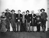 Stagecaost movie cast members in costume with Claire Trevor, John Wayne, Andy Devine, John Carradine, Louise Platt, Thomas Mitchell, Berton Churchill, Donald Meek and George Bancroft.