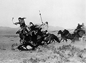 Yak Canutt, the ultimate stuntman, takes a spill with his horse during a chase scene in the film Stagecoach