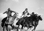 "A close-up of Navajo Indians, portraying attacking Apache warriors, ride to intercept the Overland Stage as it tries to evade a raiding party.  John Ford's ' Stagecoach"", 1939."