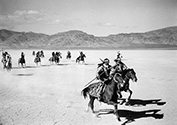 A full retinue of attacking Apache warriors rides to intercept the Overland Stage in a raid directed by Geronimo who was terrorizing the region at the time.  John Ford's 'Stagecoach', 1939.