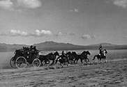 The stagecoach full of terrified passengers attempts to outrun Apache attackers during a raid by Geronimo, the notorious villain in John Ford's 'Stagecoach', 1939.